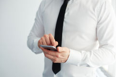 Man holding a mobile phone Stock Images