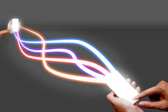 Man holding mobile phone and fiber optical light network. royalty free stock photography
