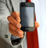 Man holding mobile phone. Image of a businessman showing his new mobile phone Stock Photography