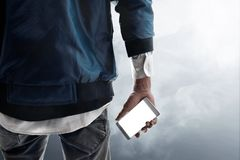 Man holding phone on smoke background stock photos