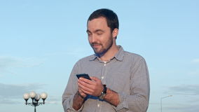 Man holding mobile smartphone using app texting stock footage