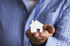 Man Holding Model House In Palm Of Hand Royalty Free Stock Photos