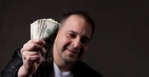 Man Holding Money Stock Photos