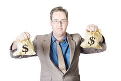 Man holding money bags on white background Royalty Free Stock Photo