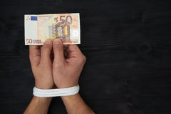 Man holding money with hands tied up Royalty Free Stock Photos