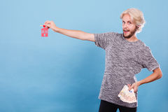 Man holding money and keys to house Royalty Free Stock Images