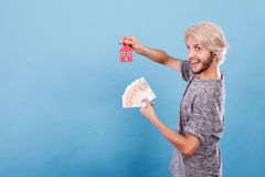 Man holding money and keys to house Royalty Free Stock Photo