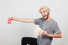 Man holding money and keys to house Stock Images
