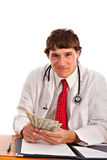 Man Holding Money with Smirk Expression Royalty Free Stock Photography