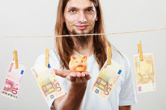 Man holding moneybox piggybank Stock Photography