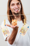 Man holding moneybox piggybank Royalty Free Stock Images