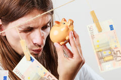 Man holding moneybox piggybank Royalty Free Stock Photography