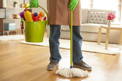 Man holding mop and plastic bucket Royalty Free Stock Photography