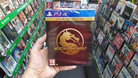 Man holding Mortal Kombat 11 Premium edition videogame on Sony Playstation 4 console in store. Bratislava, Slovakia, april 25, 2019: Man holding Mortal Kombat 11 royalty free stock photo