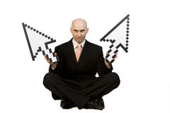 Man Holding Mouse Pointers. A man in a business suit is sitting down holding mouse pointer arrows Stock Photography