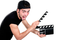 Man holding a movie clap. A smiling man holding a movie clap isolated on white background Stock Image