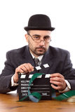 Man holding movie clapboard. Old fashioned man holding movie clapboard Royalty Free Stock Images