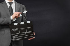 Man holding movie clapper board Stock Image