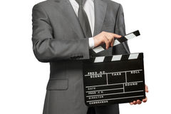 Man holding movie clapper board on white. Man holding movie clapper board isolated on white background Royalty Free Stock Photo