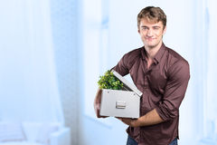 Man is holding a moving box Royalty Free Stock Photo