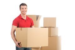 Man holding moving box and smiling at camera. Royalty Free Stock Images