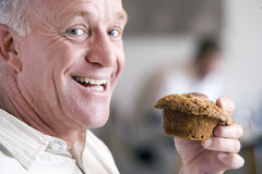 Man holding a muffin Stock Image