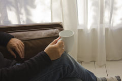 A man holding a mug Stock Photography