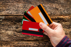Man holding multiple credit cards Stock Photography
