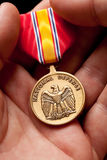 Man Holding National Defense War Medal Royalty Free Stock Photography