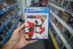 Man holding NBA 2K18 videogame on Sony Playstation 4 console in store. Bratislava, Slovakia, october 2 2017: Man holding NBA 2K18 videogame on Sony Playstation 4 Royalty Free Stock Photos