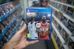 Man holding NBA Live 18 videogame on Sony Playstation 4 console in store. Bratislava, Slovakia, october 2 2017: Man holding NBA Live 18 videogame on Sony Royalty Free Stock Photography