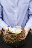Man holding nest of money, vertical Stock Photos