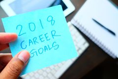 Man holding New year career goal written on colored sticker notes.  Stock Photos