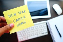 Man holding New year career goal written on colored sticker notes.  Royalty Free Stock Photos