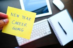 Man holding New year career goal written on colored sticker notes.  Royalty Free Stock Photo