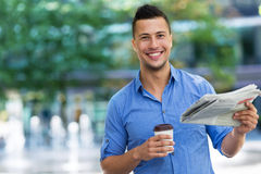 Man holding newspaper and coffee Royalty Free Stock Photo