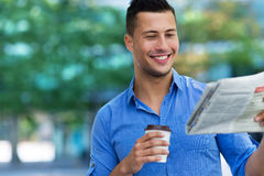 Man holding newspaper and coffee Stock Photography