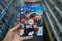 Man holding NHL 18 videogame on Sony Playstation 4 console in store. Bratislava, Slovakia, october 2 2017: Man holding NHL 18 videogame on Sony Playstation 4 Royalty Free Stock Image