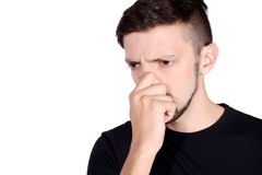 Man holding nose against bad smell. Royalty Free Stock Images