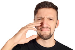 Man holding nose against bad smell. Stock Photography