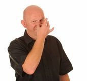 Man holding nose for smell stock photo