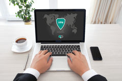 Man holding notebook app vpn creation Internet protocols protect Royalty Free Stock Photography
