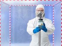 Man holding nuclear waste container Stock Photos