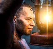 Man holding oil lamp Stock Photos
