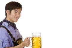 Man holding Oktoberfest beer stein (Mass) Stock Image