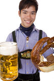 Man holding Oktoberfest beer stein and Pretzel Stock Photography