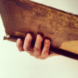 Man holding old book Stock Images