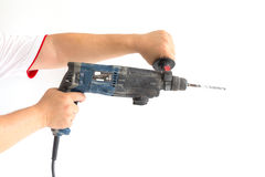 Man holding old electric drill. Isolated on white Stock Photo