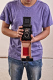 Man holding old photographic camera in hands Stock Images
