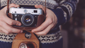Man holding old retro camera in hands Royalty Free Stock Photography